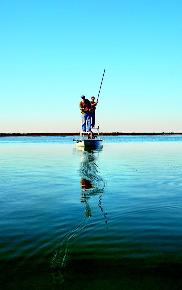 Poling the skiff and casting at low tide