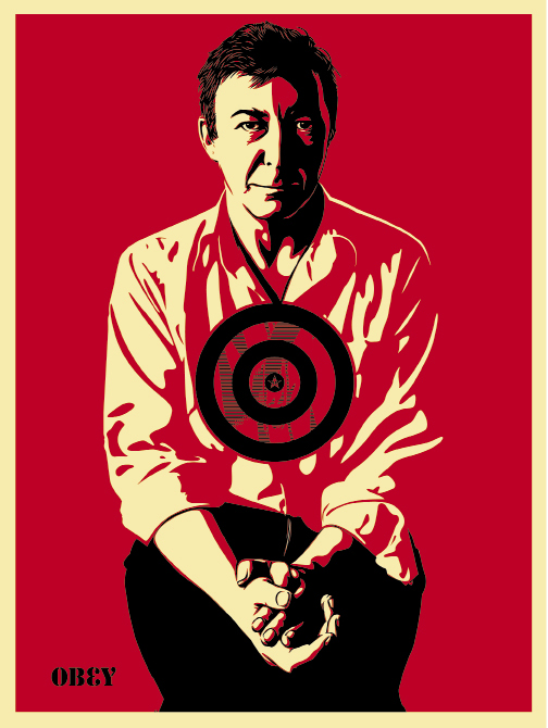 """Fairey created these Warhol-esque prints of his """"hero,"""" Jasper Johns, emblazoned with Johns' well-known target in 2010. Jasper Johns (Red) and Jasper Johns (Cream), screen prints, 18 x 24 inches, based on a photograph by Michael Tighe"""