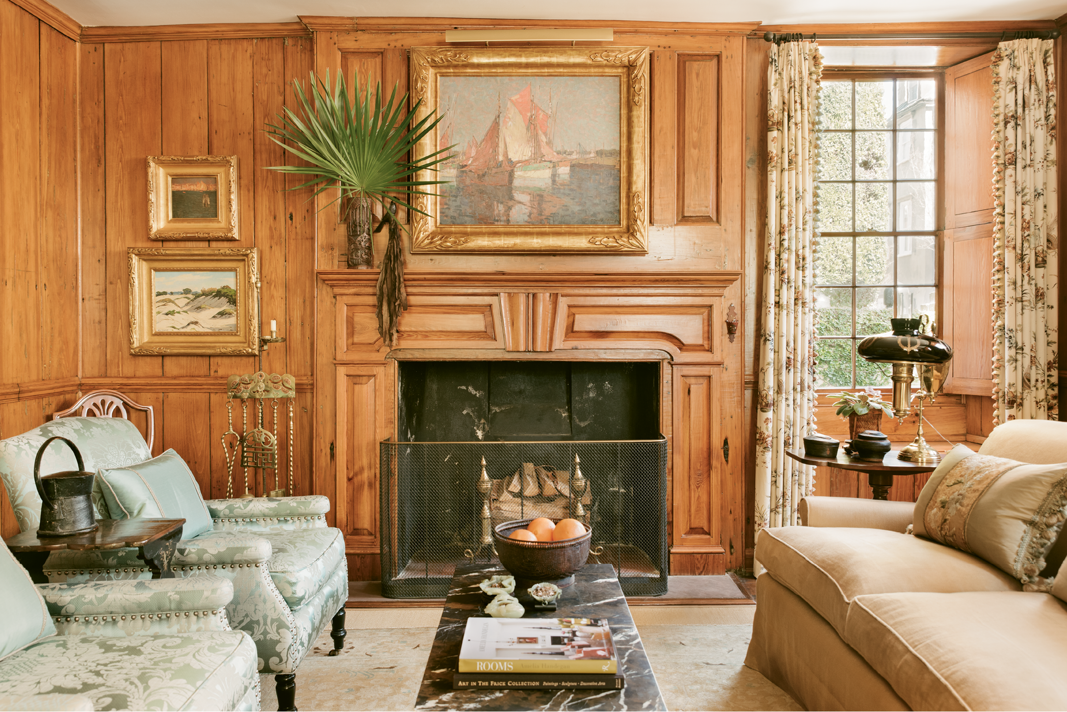 At one point, the original cypress paneling in this room was hidden under more than 20 layers of paint; upon moving in, the Seegers hired artisans to continue the previous owner's restoration of the wood.