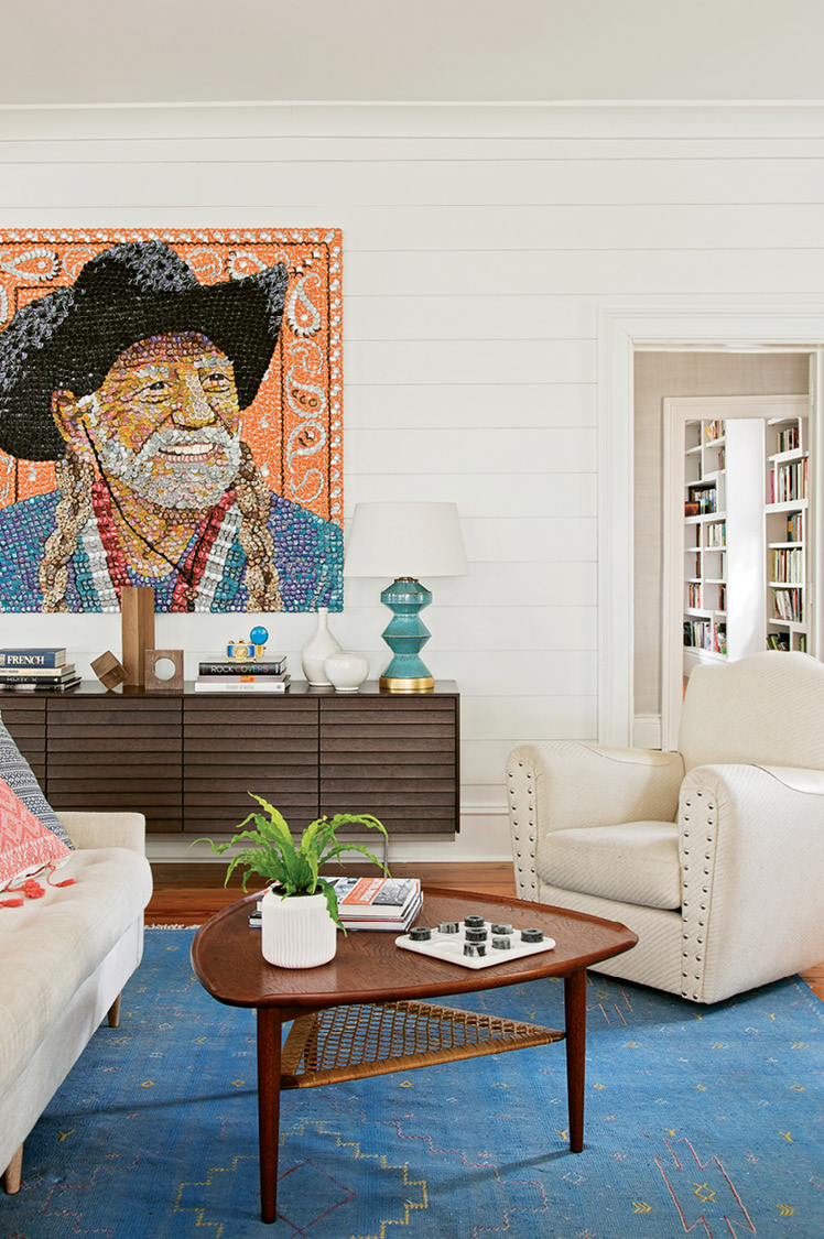 """A Molly B. Right portrait of Willie Nelson—dubbed """"Bottlecap Willie"""" by Sam-—presides over the scene."""