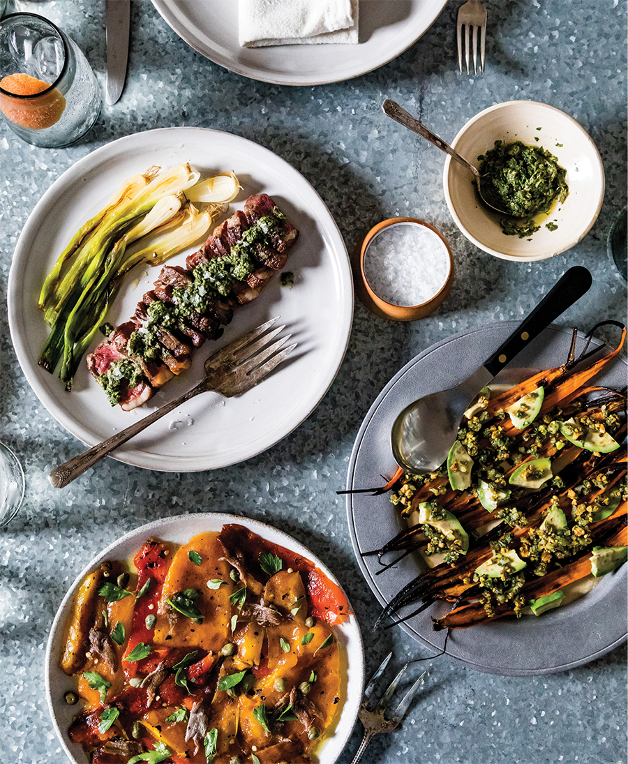 For a presentation that's a little more rustic, Reitz mixes the herby green sauce by hand to serve with bison strip steaks (above), tears the charred peppers rather than chopping them (below), and roughly dices avocado to top roasted carrots.