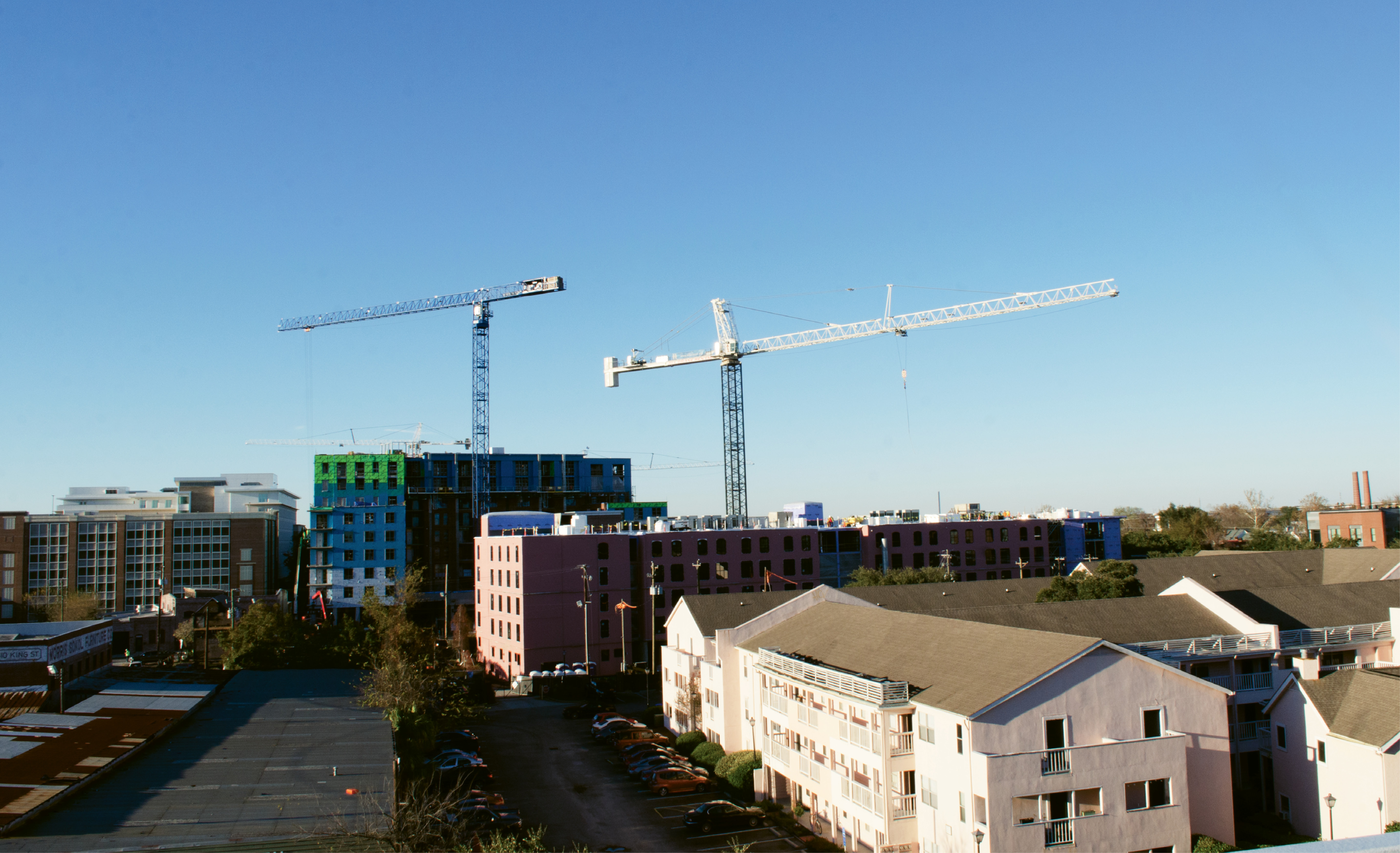 For a few years, construction cranes have dominated the downtown skyline. At right is the Courtyards at 411 Meeting Street complex, under-market rental apartments that are slated to become a 300-room hotel.