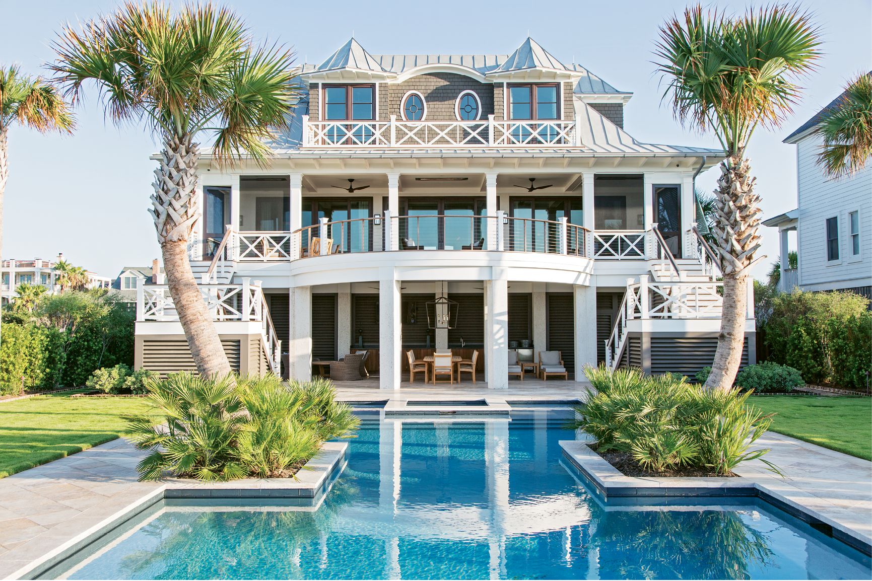 Beachside Oasis: Homeowners Mike and Mary Lamach worked with architect Steve Herlong and interior designer David Smith to conjure their vacation home; the symmetrical design is influenced by both Caribbean and Lowcountry architecture.