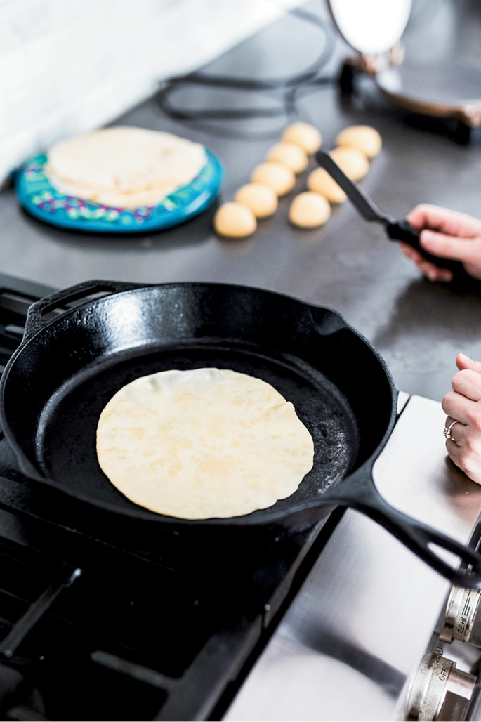 """To make tortillas more """"bubbly,"""" MariElena suggests forming the dough into balls and letting them rest for 20 minutes before rolling them out into disks."""