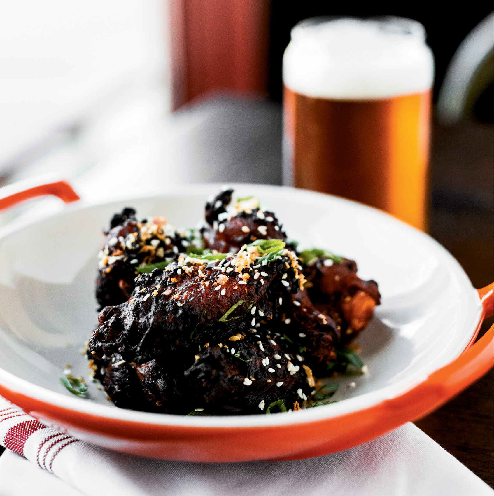 Clever Classics: Chicken wings are revamped with Korean mustard, ginger, fried garlic, and sesame seeds.