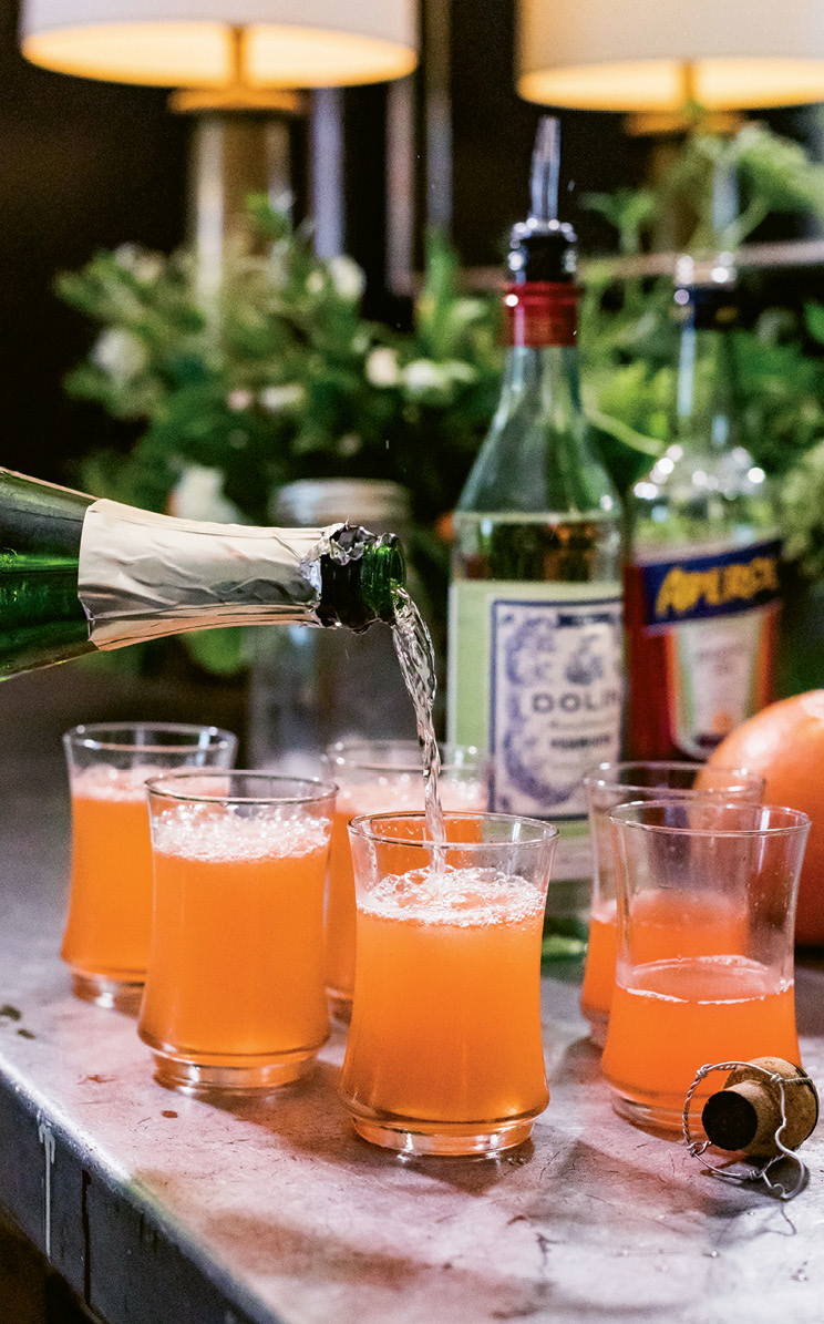 The bright grapefruit cocktails get topped off with bubbly.