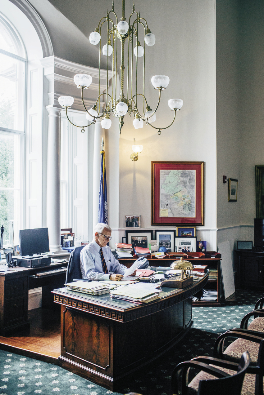 Mayor Riley holds forth from his memento-filled office at historic City Hall. Though his is decidedly not a desk job, Riley takes time from ribbon cuttings and meetings to attend to paperwork. Here the mayor, whose national prominence has risen over his tenure, signs two letters: one to President Obama and one to former New York Mayor Michael Bloomberg.