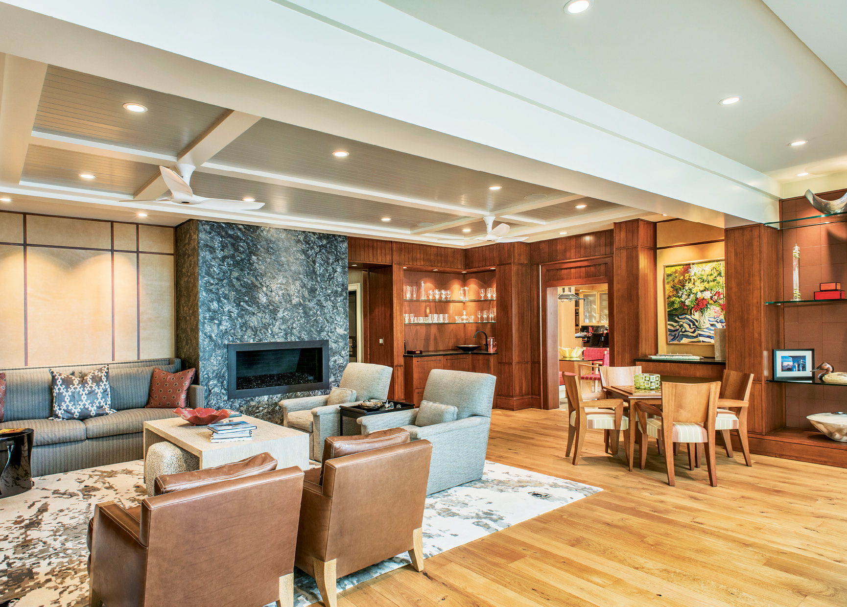 Leather panels add warmth and texture on the walls, and two sitting areas accommodate cozy conversations or big parties.
