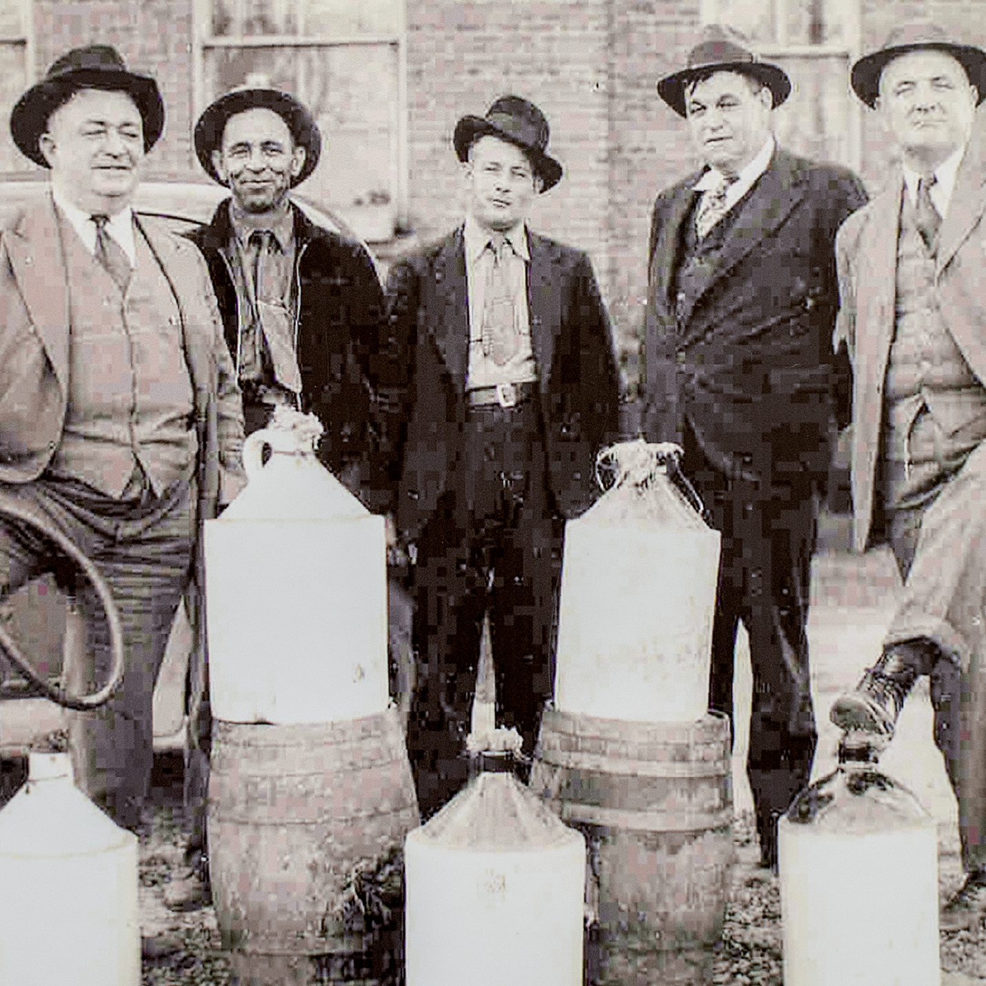 Raids of stills took place throughout the state, with authorities taking possession of the liquor, as shown in this circa-1930s photograph taken in Pickens County.