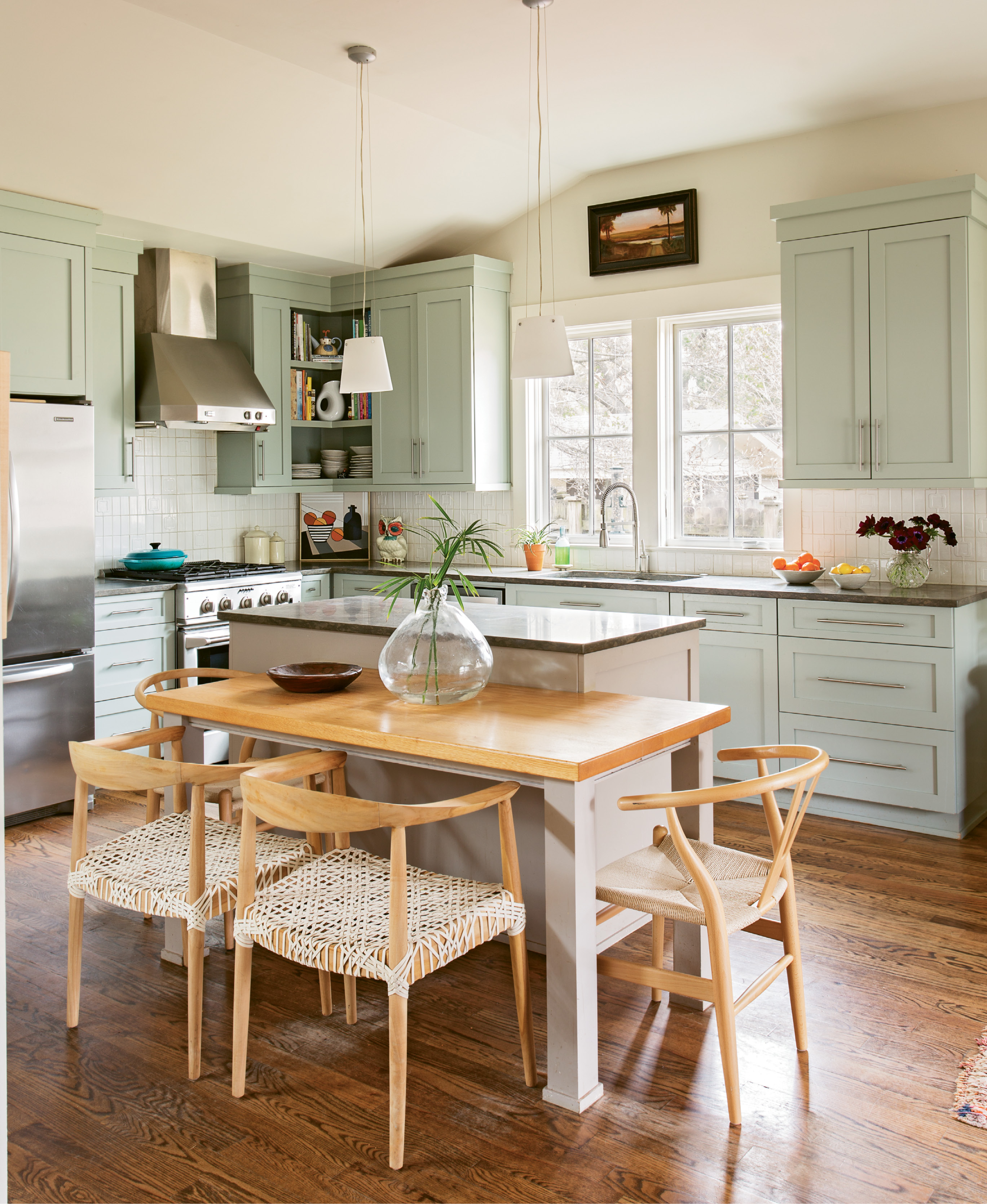 Clean Eating: In the kitchen, area carpenter Robert Buxton built the custom asymmetrical table, which adds a contemporary design element as well as an informal space for the family to gather for meals.