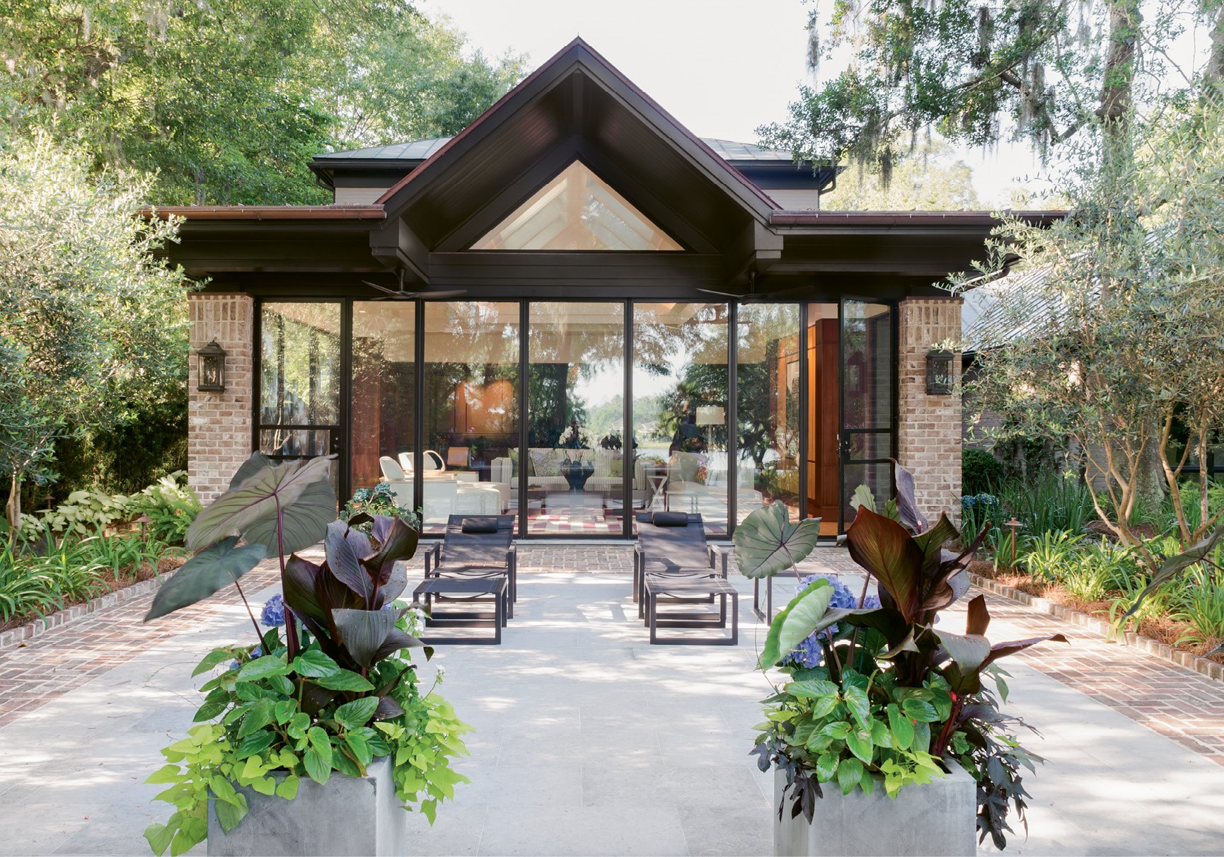 Improved Outlook: With wall-to-wall windows revealing an Intracoastal panorama, the new addition transforms what was a screened porch and dark den into an outdoors-oriented living space.