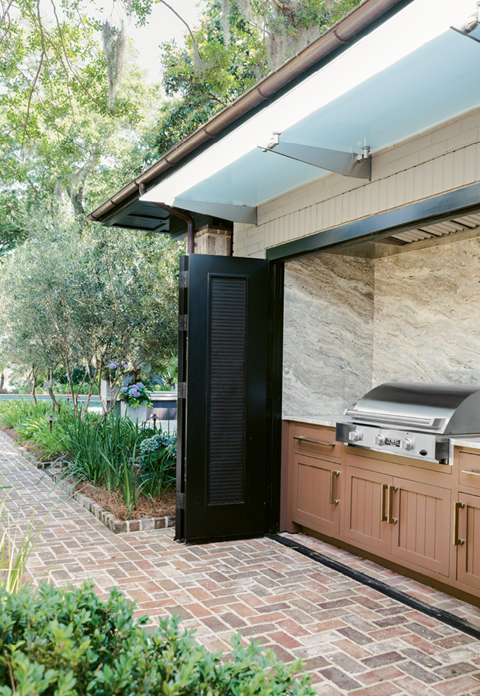 Fired Up: An outdoor kitchen makes grilling effortless for poolside dining.