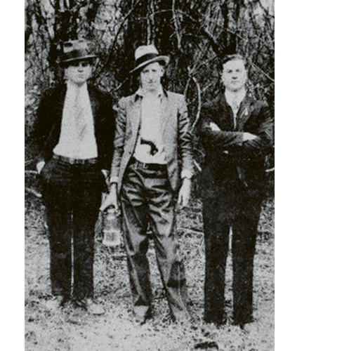 """(Left to right)  Al Capone, David Shuler, and an unknown man in Hell Hole Swamp; """"Mr. Shuler ran a mercantile store in Jamestown. This photo hung in his store until it closed,"""" says Jamestown resident Douglas Guerry."""