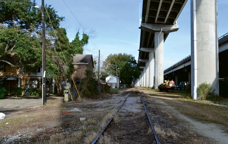 Unused Norfolk  Southern line now: Currently barren and blighted, the abandoned Norfolk Southern rail lines that run beneath I-26 through the heart of downtown will be reclaimed and turned into a multi-use linear park, connecting the Neck and the lower peninsula and adding much needed recreational and bike/pedestrian access through what is now no man's land.