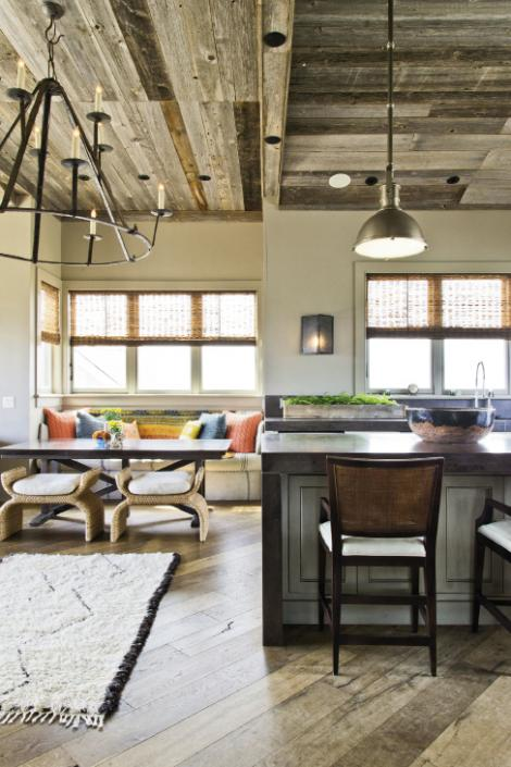 Seat Yourself: A vibrant banquette cozies up the third-floor penthouse. The woven stools are by Baker Furniture, the table by Hickory Chair, the banquette seating by local artisan Matt Decell, and the Kantha quilt from Celadon.