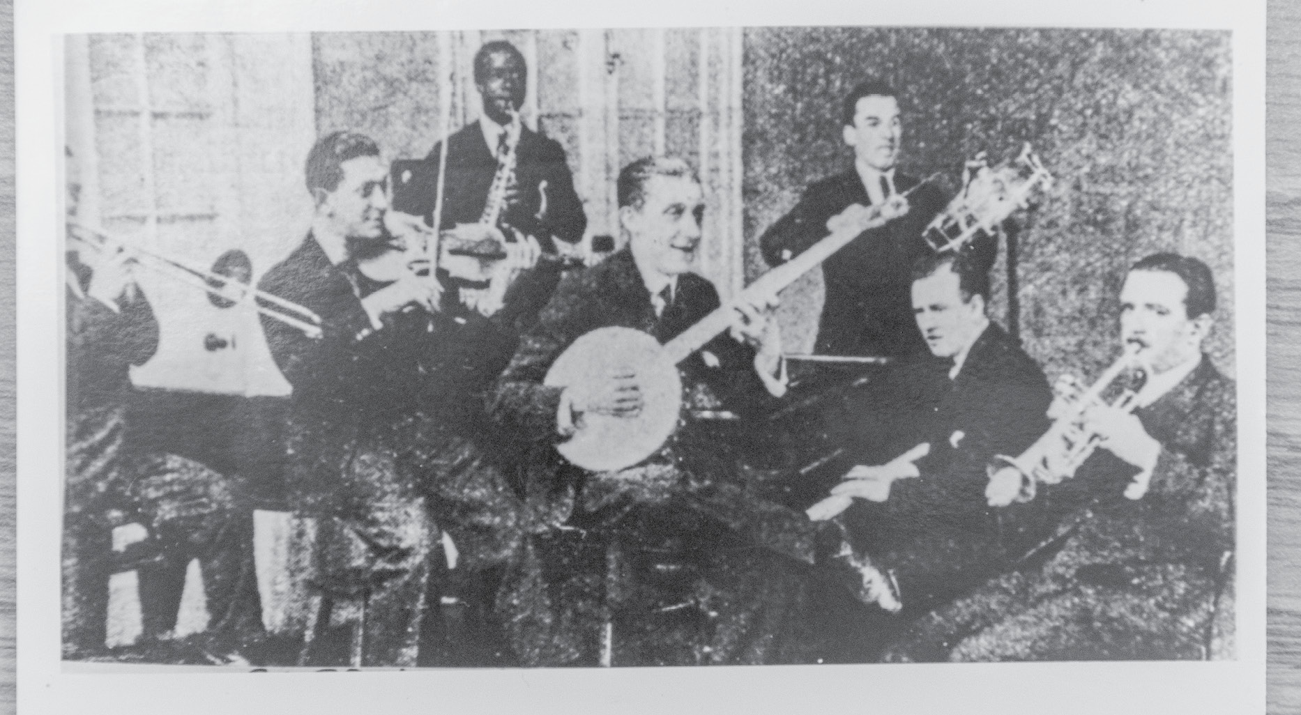 He led a popular dance band, The Queen's Dance Orchestra (pictured here in May 1921), which cut several records.