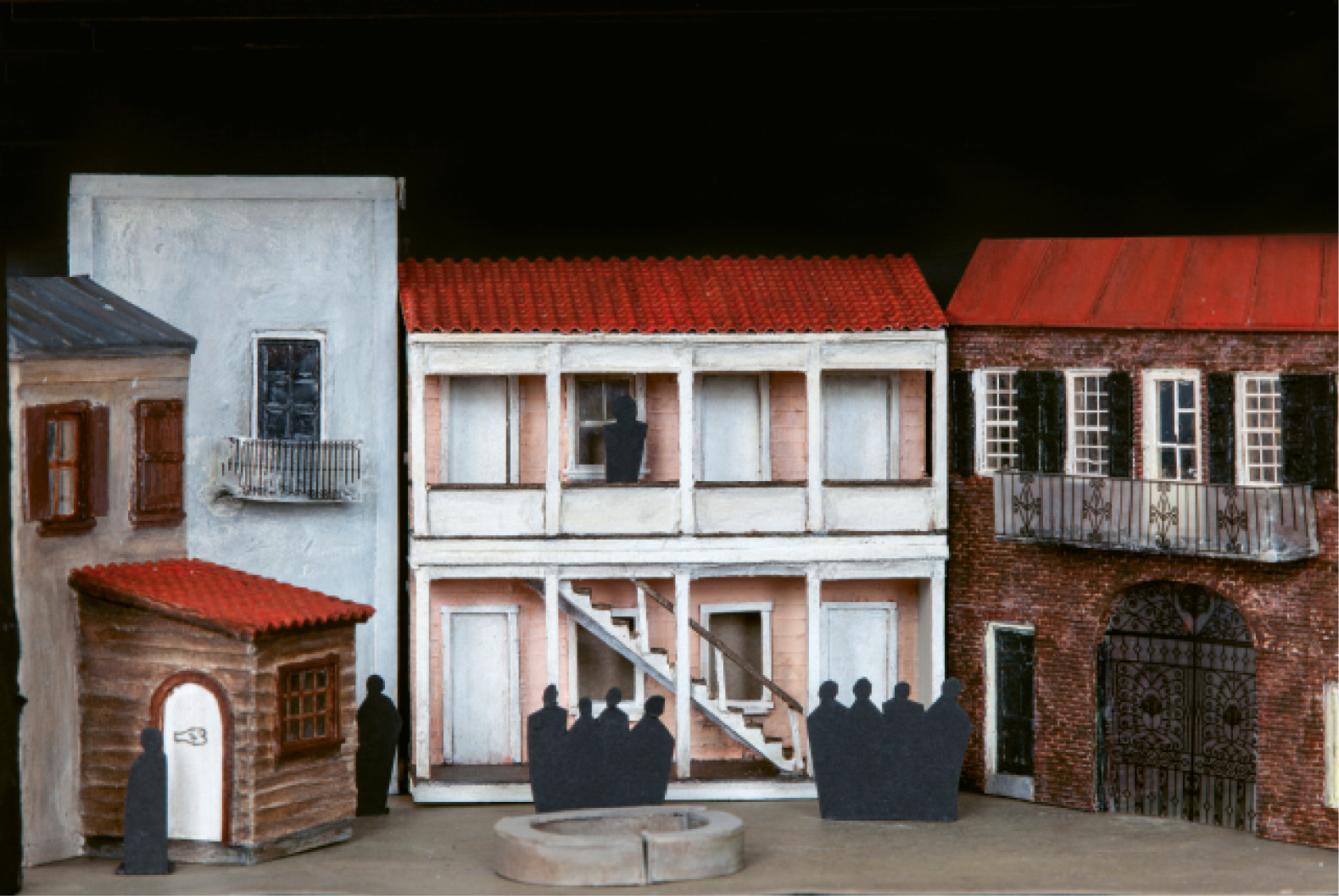 Maquettes for the sets of Porgy and Bess at the Spoleto scene shop demonstrate Green's direction, including Catfish Row, which will transform decoratively throughout the show as African design elements, such as diamond patterns, are added.