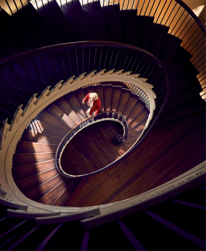 Kitty Robinson on the elliptical, free-flying staircase at Historic Charleston Foundation's circa-1808 Nathaniel Russell House