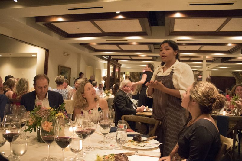 Olivia Bischoff explains her dish to guests Richard and Pam Hricik and Sara Porter.