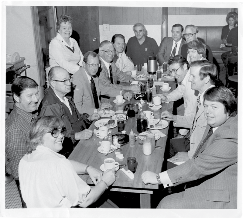 """Kitty's """"Coffee Club"""" circa 1980, its members gathered every morning at 9:15, Miss Kitty is standing on the left."""