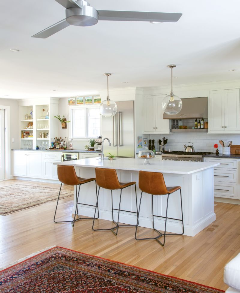 CLEAN SLATE: This Wagener Terrace home's modern kitchen may be picture-perfect today (with its West Elm barstools, sprawling marble island, and pristine subway tile), but less than two years ago it was dark, dingy, and seriously outdated.