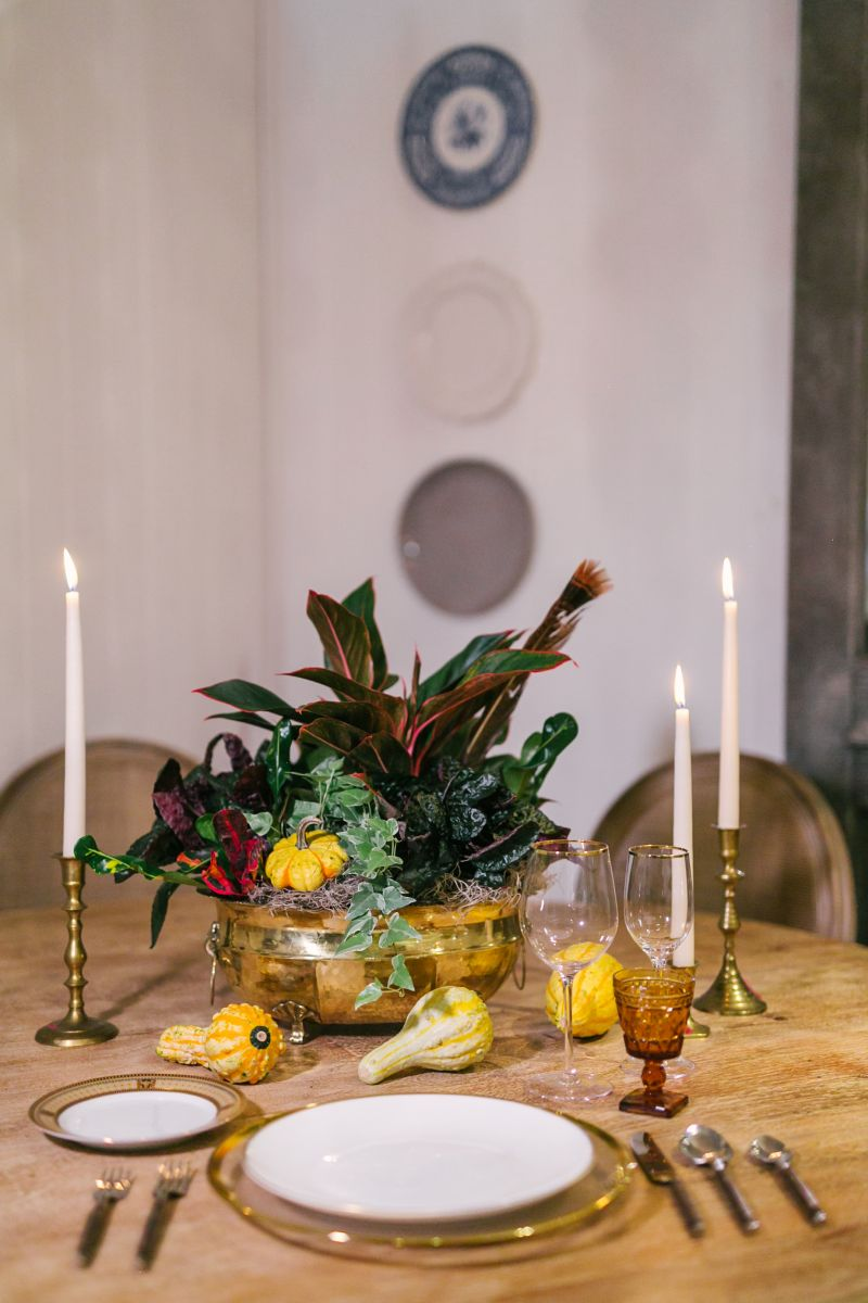 Place the finished arrangement at the center of a round table, scattering mini mini gourds and squash around it. Pillar candles add elegance; if you're going for a less-formal look, votives will be spot-on.