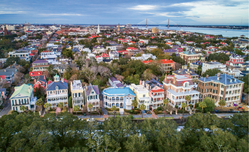 """South Battery & King"" {Altitude: 120 feet}  Flying above the oaks in White Point Garden offers a new vantage point to take in the historical homes on South Battery, with the Holy City skyline and Charleston Harbor in the background."