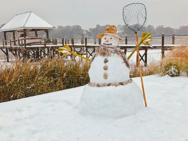 <strong>In the Marsh We Can Build a Snowman:</strong> In West Ashley, the Lipov family built the quintessential Lowcountry snow-fisherman, complete with palmetto frond hands and oyster shell buttons; <em>photograph by Larry Lipov</em>