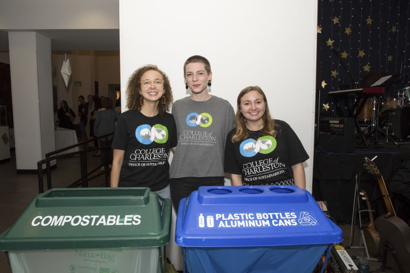Harmony Baggett, Mikayla Drost, and Brynn Smith with C of C's Office of Sustainability advise guests on proper recycling practices.