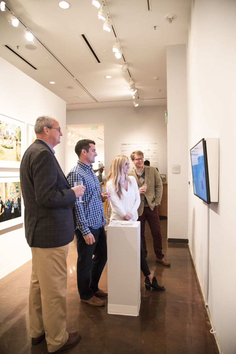 """Attendees take in works in the """"Southbound"""" exhibition."""