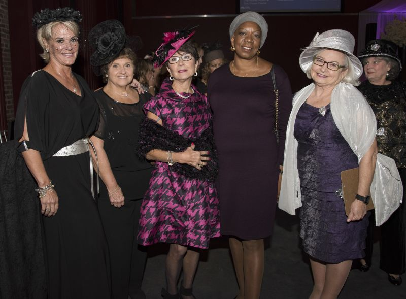 Attendees dressed to the nines for the event, like these ladies donning fascinators.