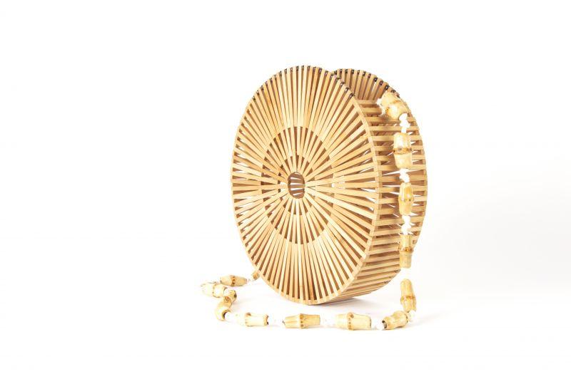 Moda Luxe circular wooden bag, $96 at Tres Carmen