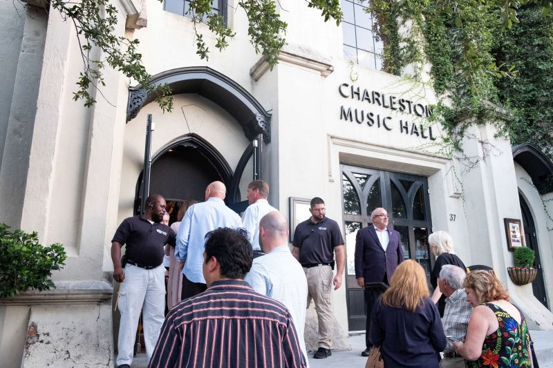 Guests file into the Music Hall before the show.