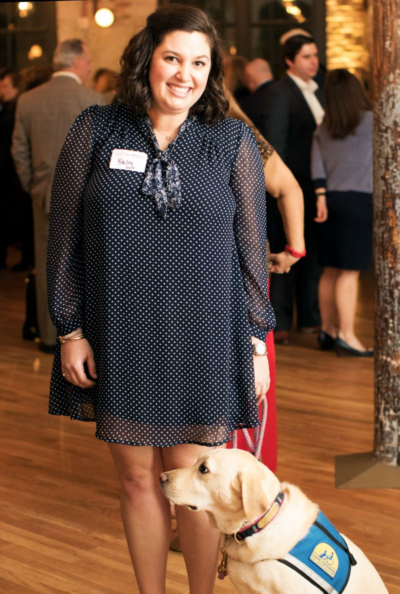 Dee Norton therapist Bailey Jackson and the organization's therapy dog, Poppy
