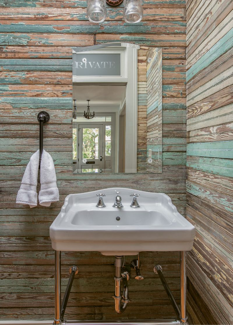 Though not original to the house, the half-bath adds some much-needed 21st-century convenience; beadboard salvaged from the back porch was repurposed as wall paneling, retaining a sense of the home's history.