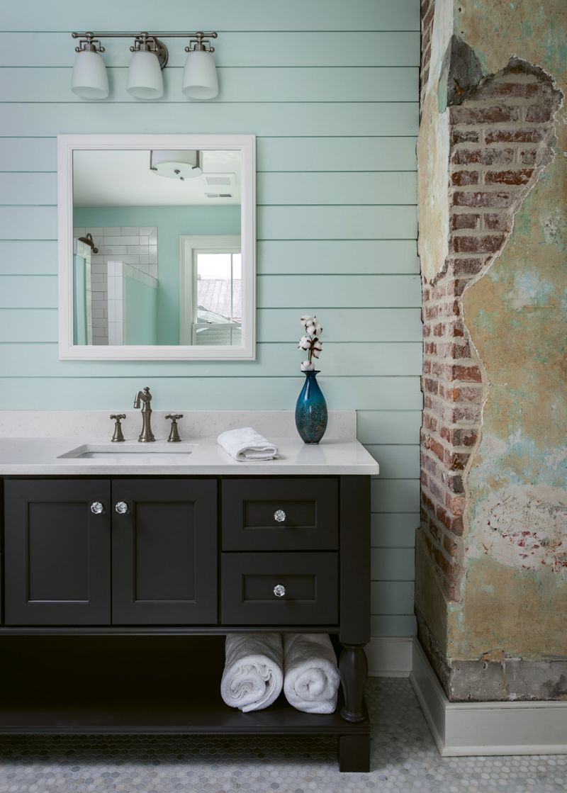 When Engelke's crew had trouble removing all the plaster from the brick column in the master bath, Cindy decided to embrace it. She's come to love the patina it adds to the space.