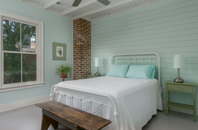 """Shiplap walls in Behr's """"Whipped Mint"""" set a serene mood in the master bedroom."""