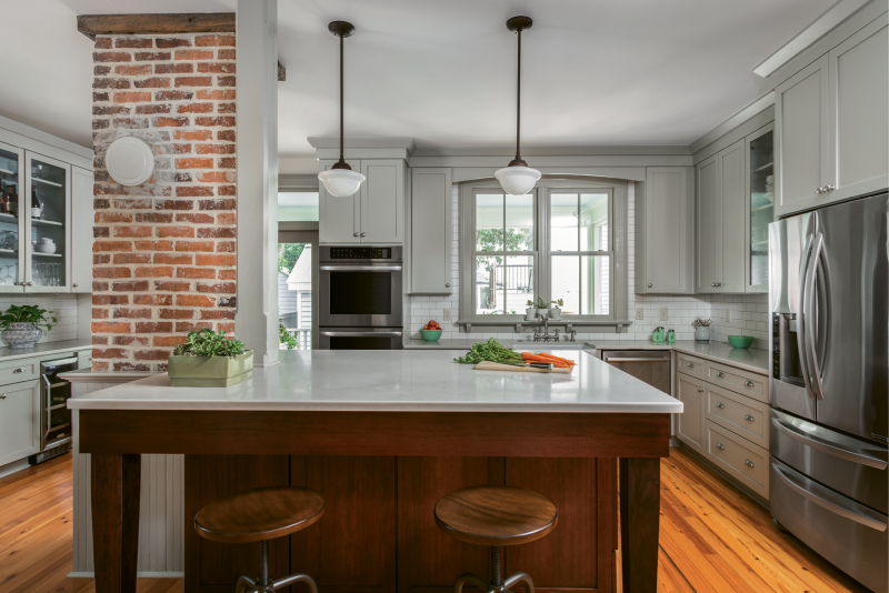In the kitchen, Engelke repurposed an antique porch column to provide necessary structural support. Most evenings, the Ellsworths can be found here, eating dinner or just hanging out at the quartz-topped island.