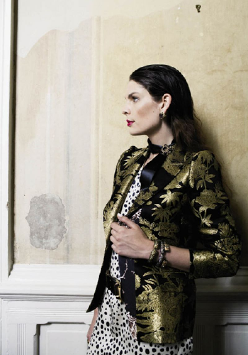 """Birdie"" silk tunic by Tucker, $315 at Hampden Clothing; Dries Van Noten gold and black brocade jacket, price upon request at RTW; 14K gold earrings with grey mother-of-pearl, $1,870 at Croghan's Jewel Box; ribbon, stylist's own; vintage 14K gold and smoky quartz brooch, $1,500 at Joint Venture; Matthew Campbell Laurenza sterling bangles with yellow sapphire and small citrine, $2,050, yellow sapphire, $1,700, and orange sapphire and large citrine, $1,835, all at Paulo Geiss & Sons; Suzi Roher"