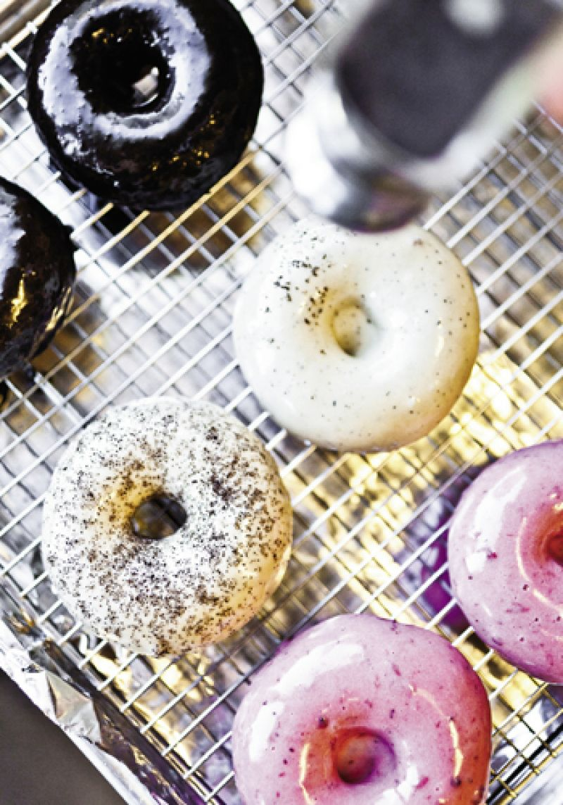 dark chocolate, cappuccino glaze with espresso dust, and lingonberry doughnuts