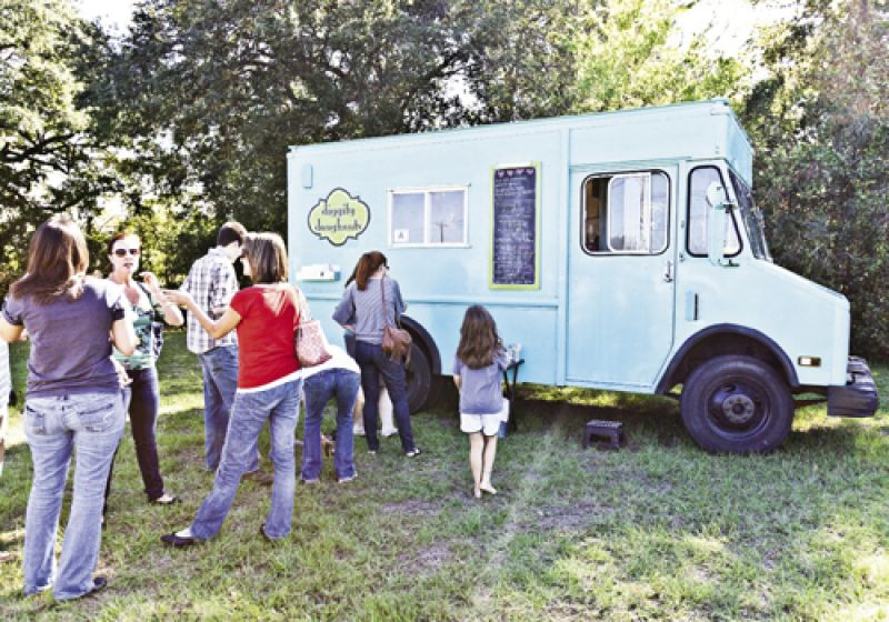 The Diggity Doughnuts team works to keep up with the growing crowd.