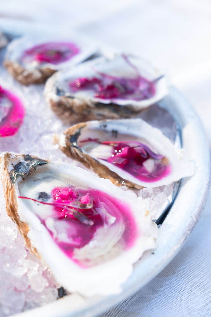 Turning bright fuschia from a topping of muscadine vinegar, diced daikon radish, and beets, The Obstinate Daughter's oysters were certainly eye-popping