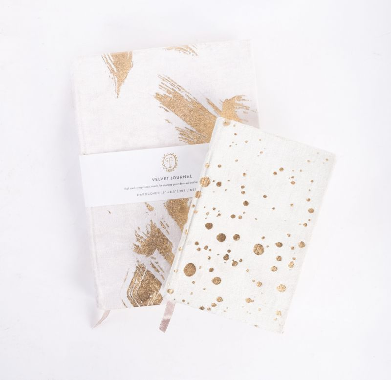 Print Fresh Studio medium velvet journal, $33, and small velvet journal, $22, both available at Out of Hand