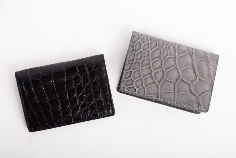 W. Kleinberg glazed alligator ID case, $425, and matte ID case, $450, both available at Gwynn's of Mount Pleasant