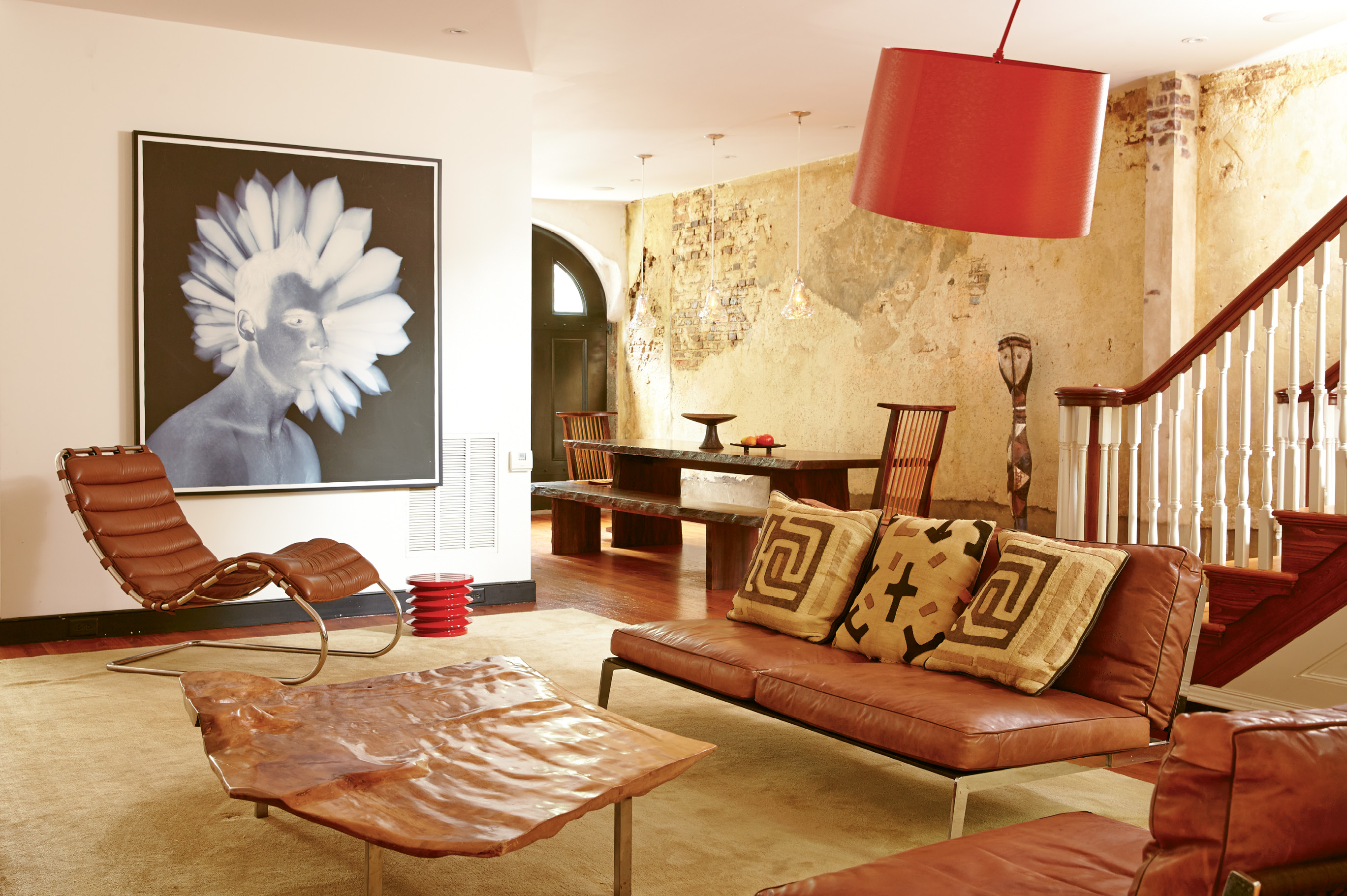 OUT OF AFRICA: Exotic textiles and a sculpture from Suzanne's time in Africa lend a global bent to this dining and lounge space.
